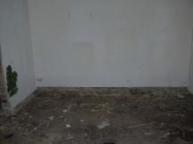 Ehemaliges Wohnzimmer ohne Bodendielen